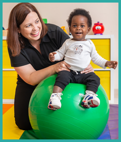 Nurse Working with Toddler on Balance Ball